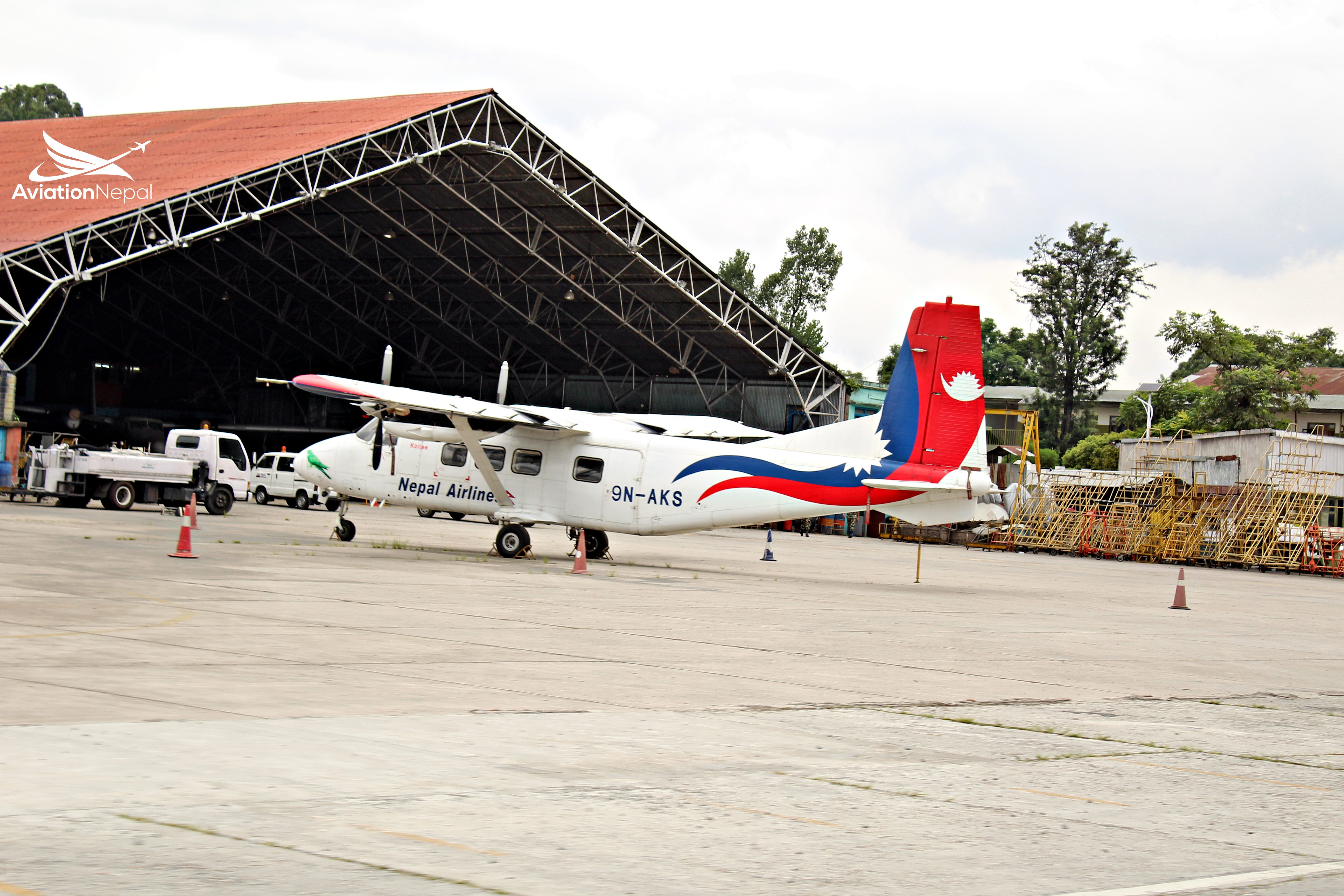 Grounded Harbin Y12-e infront of Nepal Airliness Hangar.